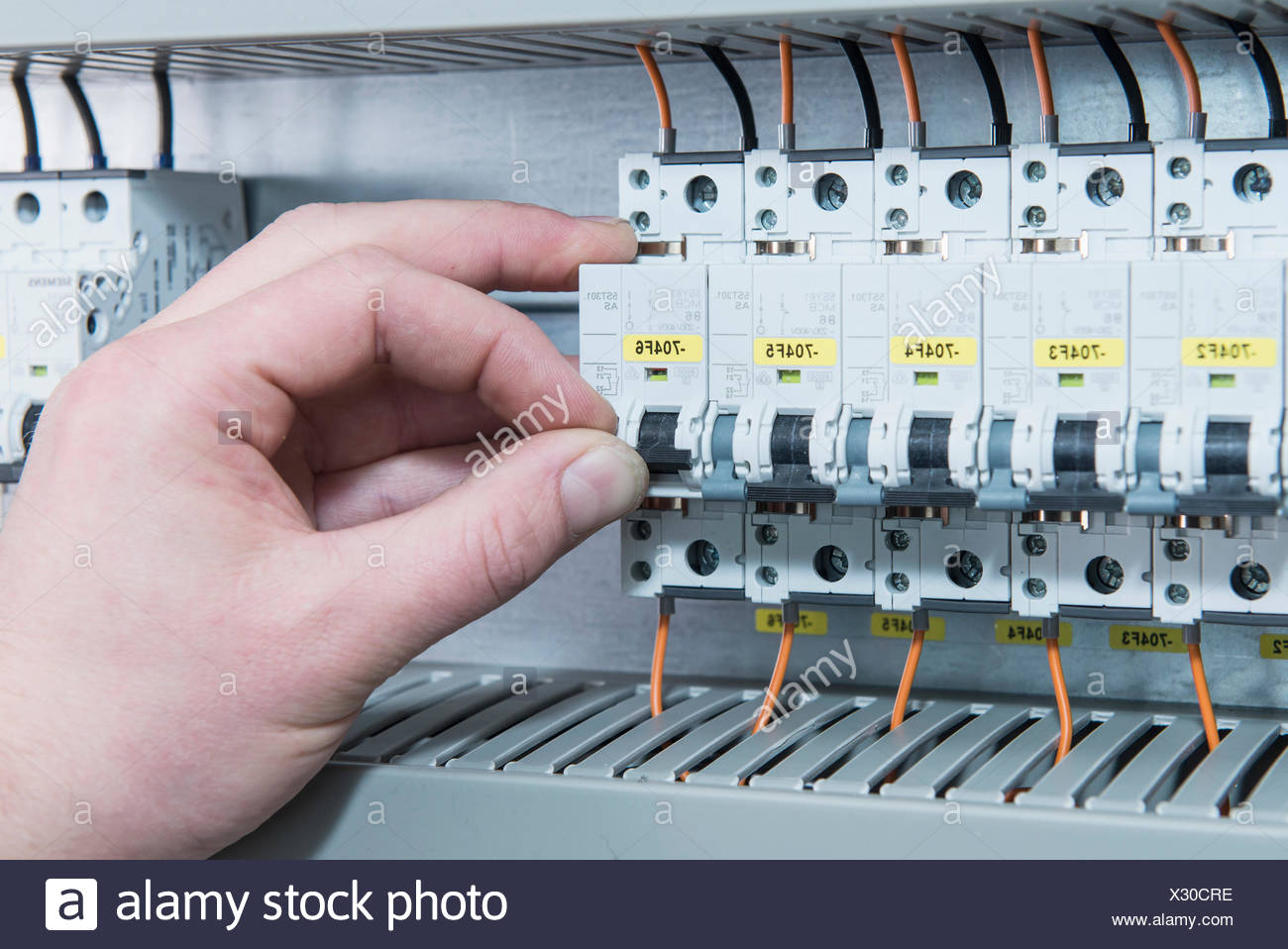 Close Up Of Electrician Switching Electrical Fuse In Distribution Electric Home Box Fusebox Munich Bavaria Germany