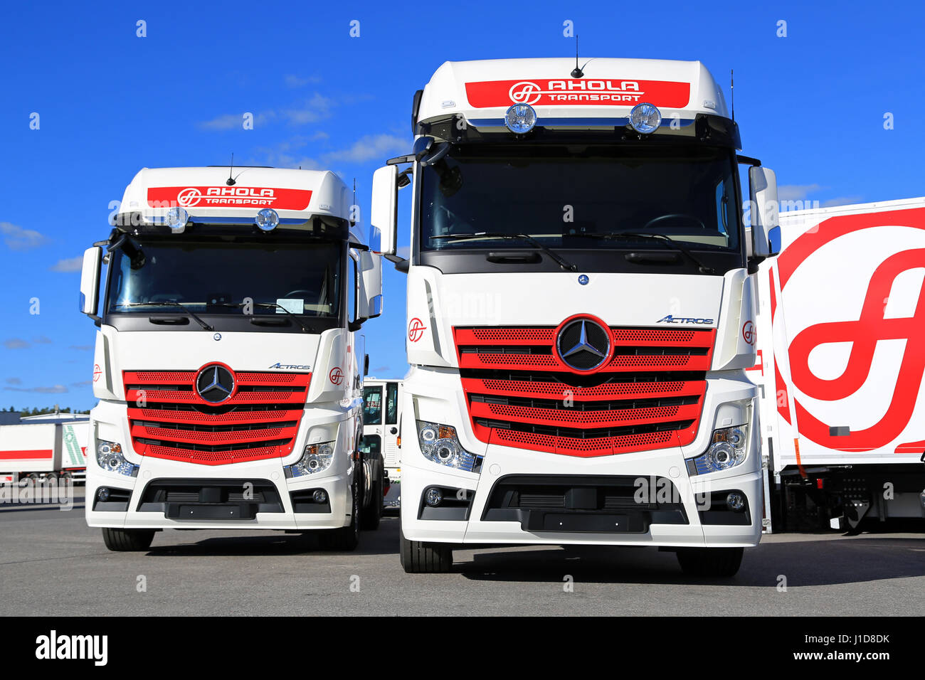 NAANTALI, FINLAND - SEPTEMBER 16, 2016: Mercedes-Benz Actros 2551 cargo  trucks of the new visual identity of Ahola Transport on display on the  company