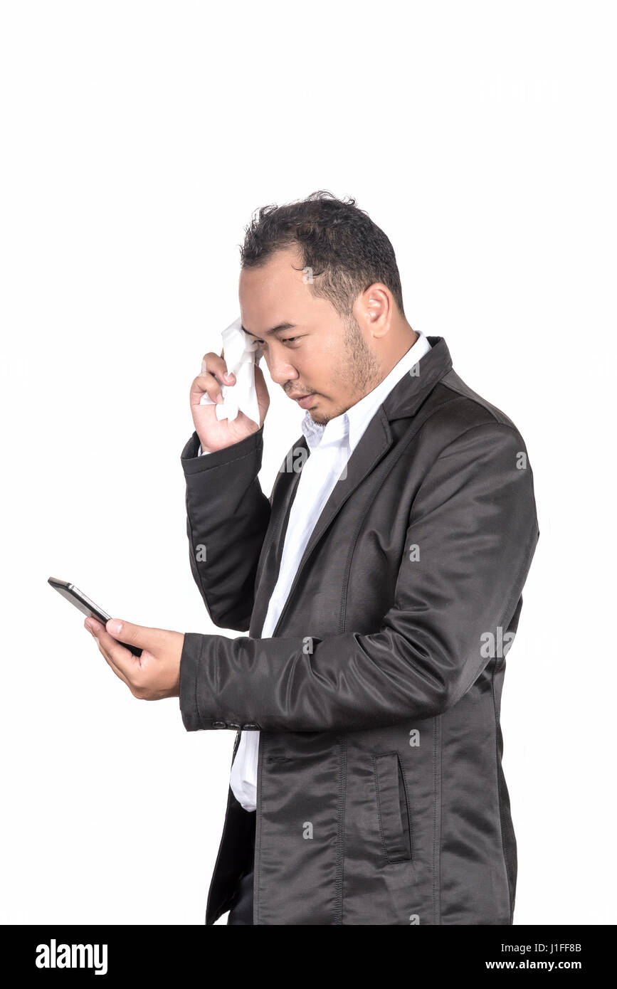 Frustrated office worker on the phone holding stock photo image - Asian Businessman Depressed And Worried About Business When He Saw Massage In Smart Phone On His