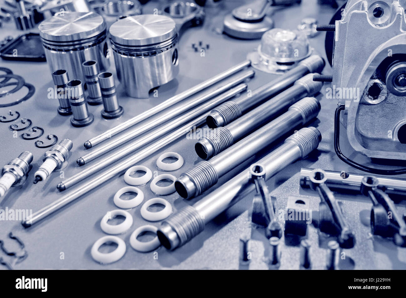 Blue toned collection of vehicle engine parts stock image