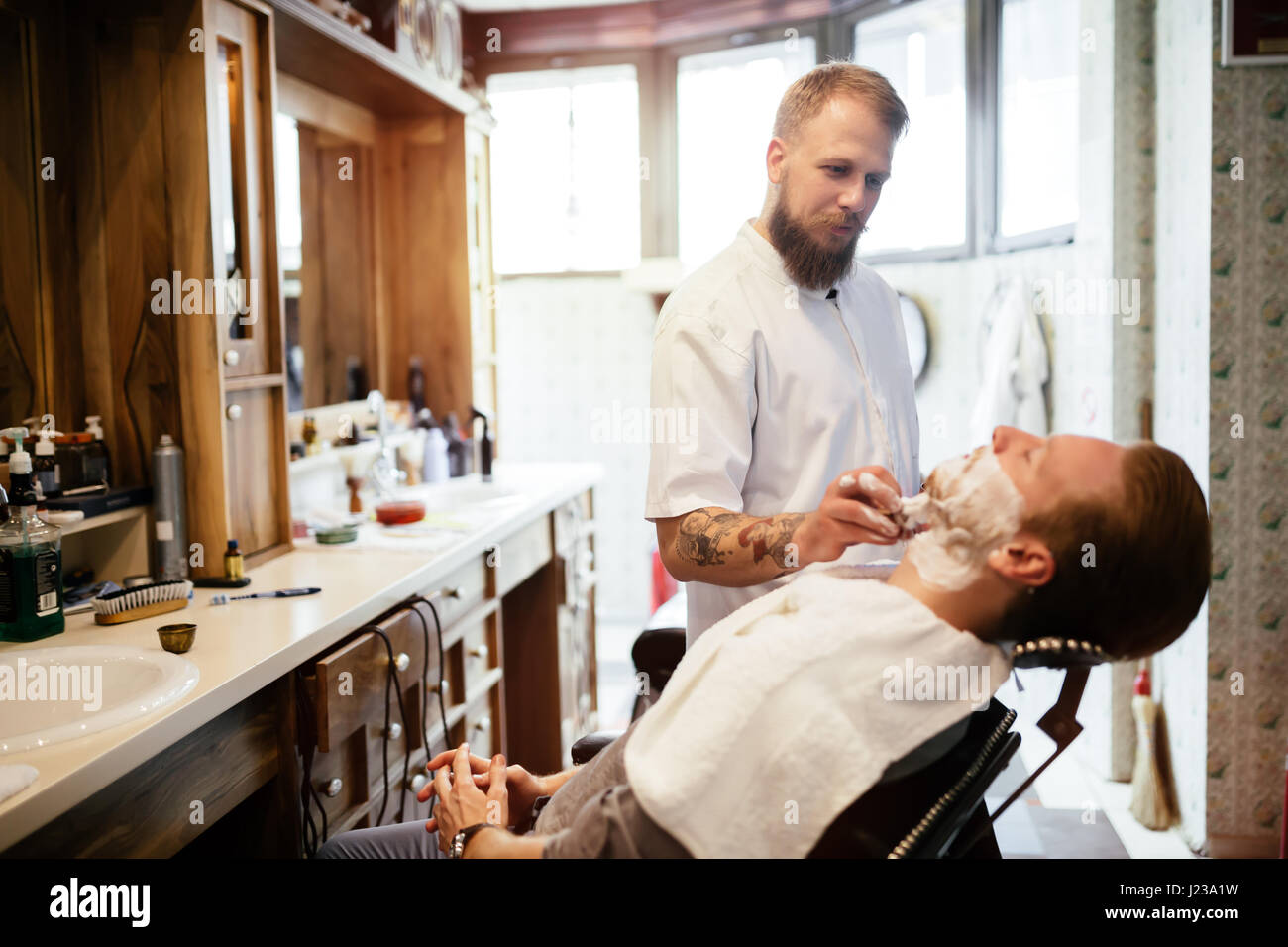 barber shaving grooming men in stock photos barber shaving grooming men in stock images alamy. Black Bedroom Furniture Sets. Home Design Ideas