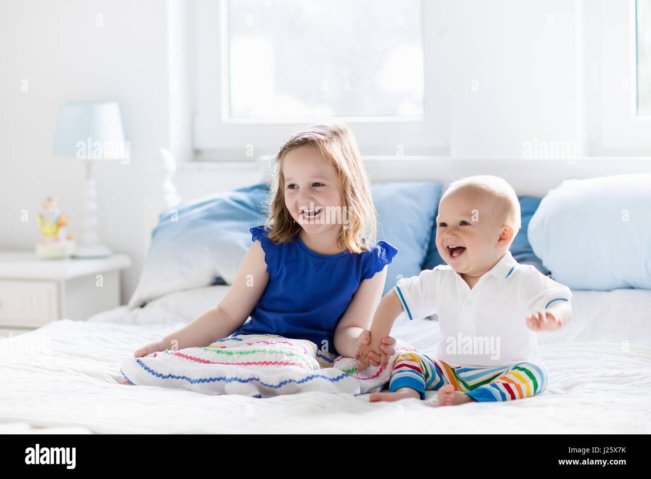 Parents baby crib stock photos parents baby crib stock for Boys and girls in bed
