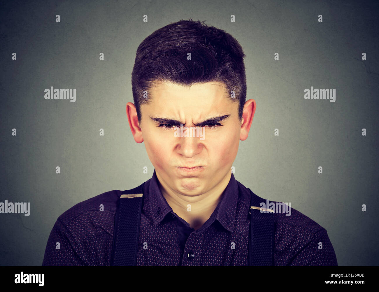 Grimace face clip art stock photo woman pulls a face in upset - Angry Young Man About To Have Nervous Breakdown Isolated On Gray Background Negative Human Emotion