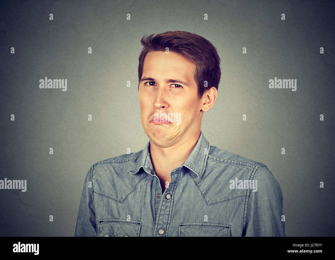 Grimace face clip art stock photo woman pulls a face in upset - Portrait Of A Disgusted Man Stock Image