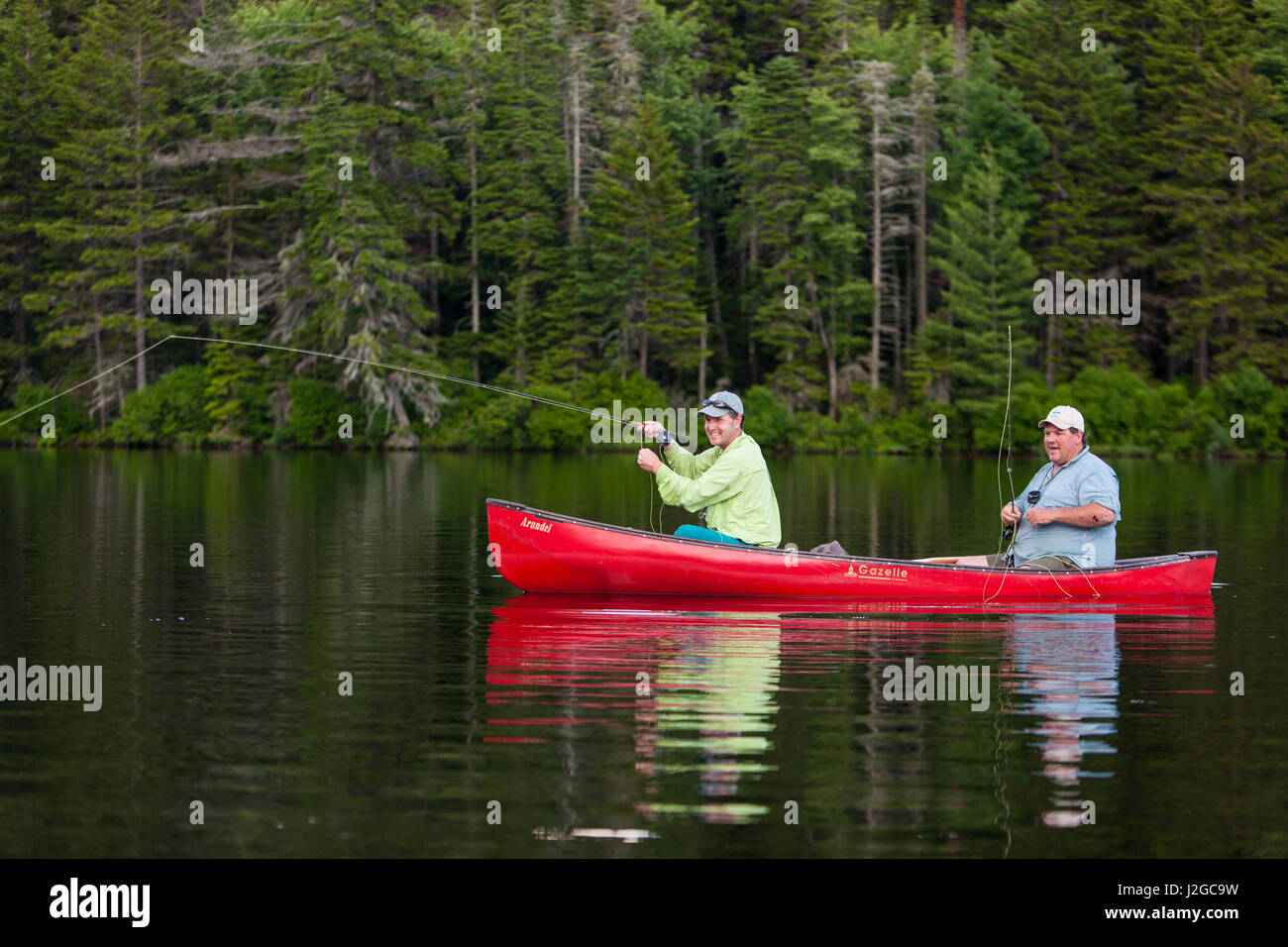 Two men fly fishing brook trout stock photos two men fly for Trout fishing ponds near me