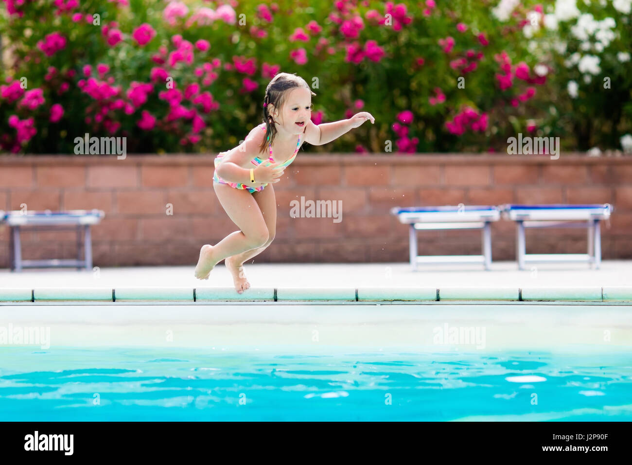 Girl Jumping Into Pool In Summer Stock Photos Girl