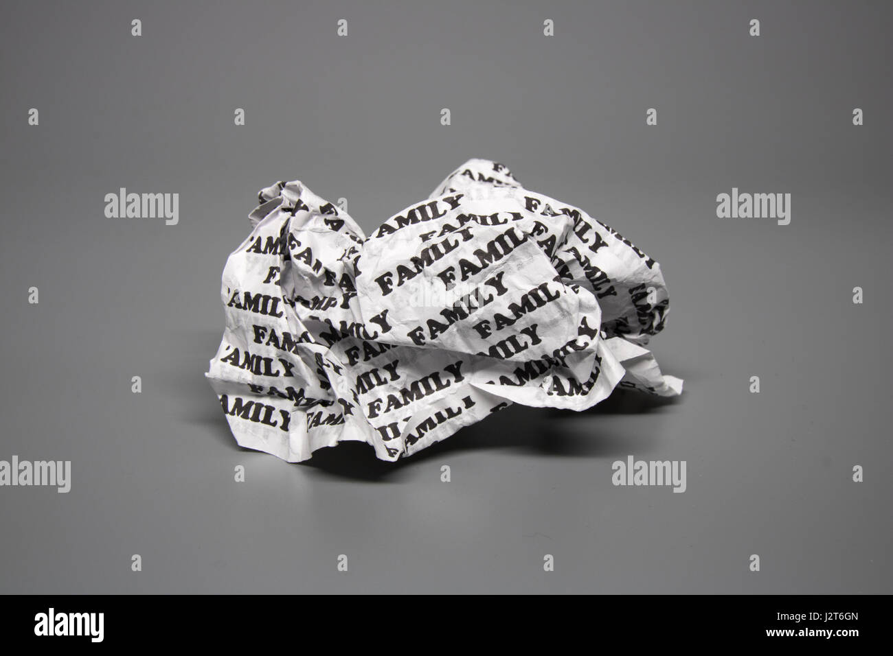 incest 3D bad onion 2 A crumpled paper with the words 'family' written all over it on a gray