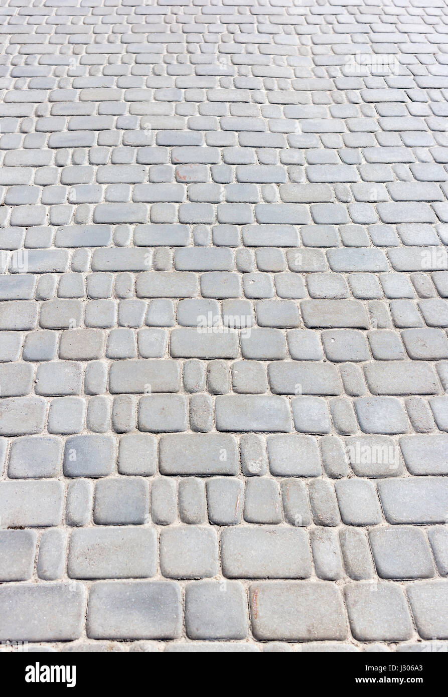 Smooth shaped white stones surface texture background stock photo - Abstract Background Texture Of Paving Stone Blocks Stock Image