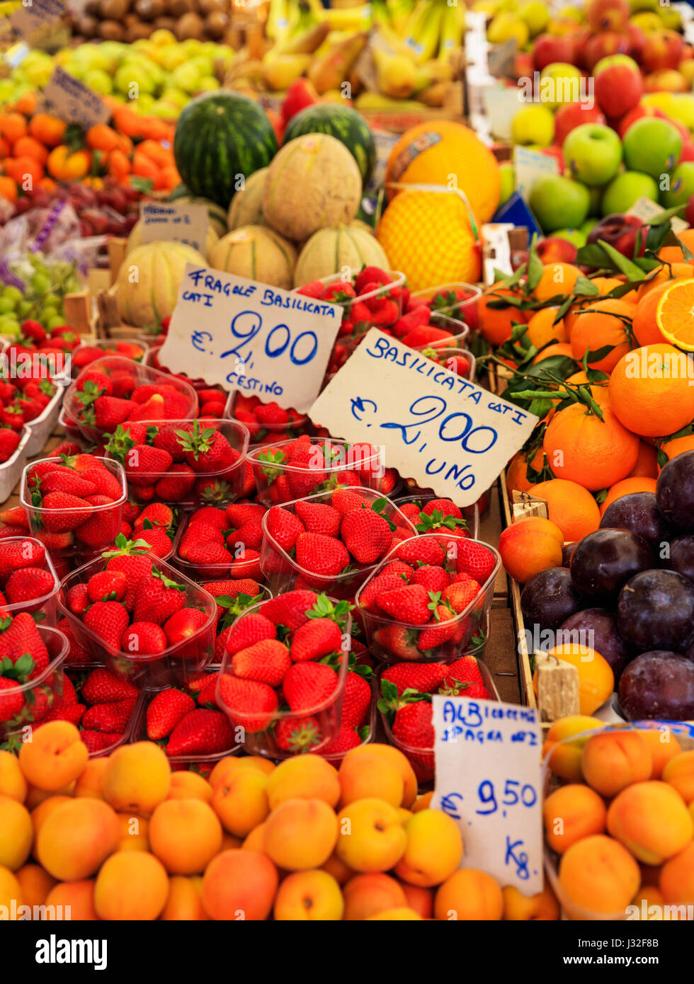 Variety of fruits for sale in an open-air market in Italy