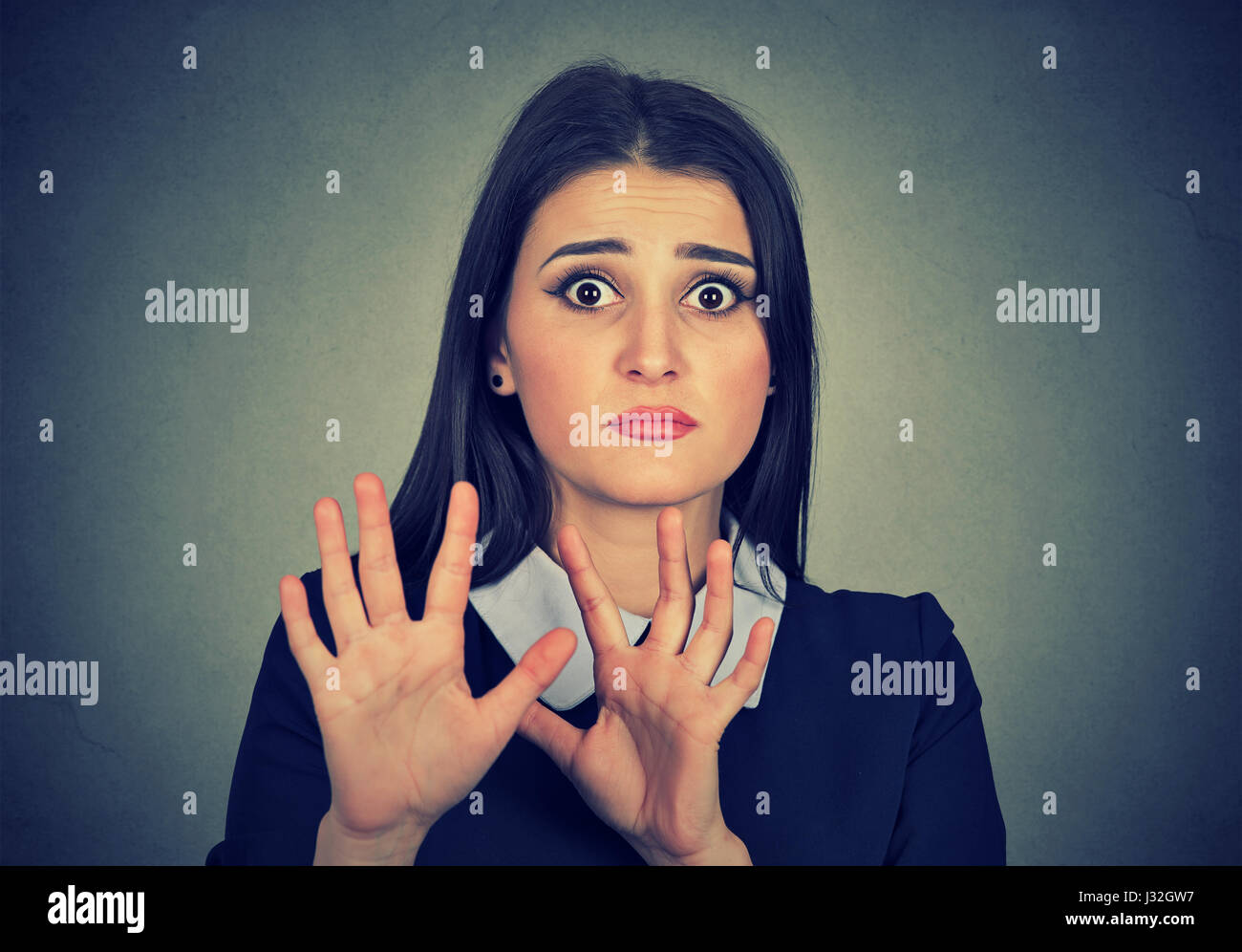 Grimace face clip art stock photo woman pulls a face in upset - Scared Woman Raising Hands Up Afraid To Be Attacked Avoiding Unpleasant Situation Isolated On Gray Background