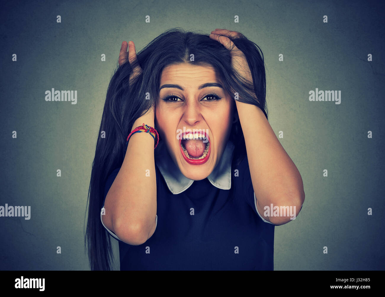 Grimace face clip art stock photo woman pulls a face in upset - Stressed Out Young Woman Pulling Her Hair Stock Image