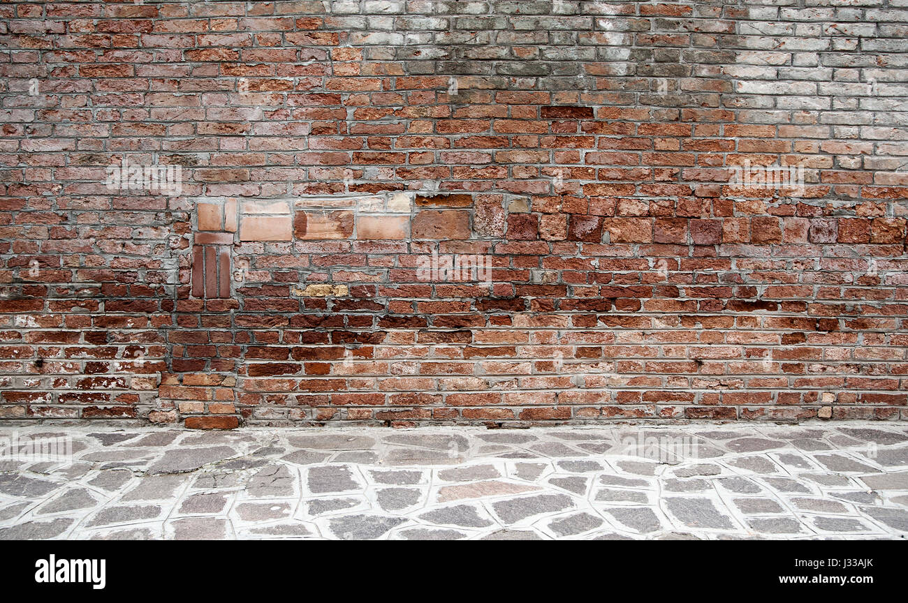 Plain wood table with hipster brick wall background stock photo - Dark Room With Tile Floor And Brick Wall Background Stock Image