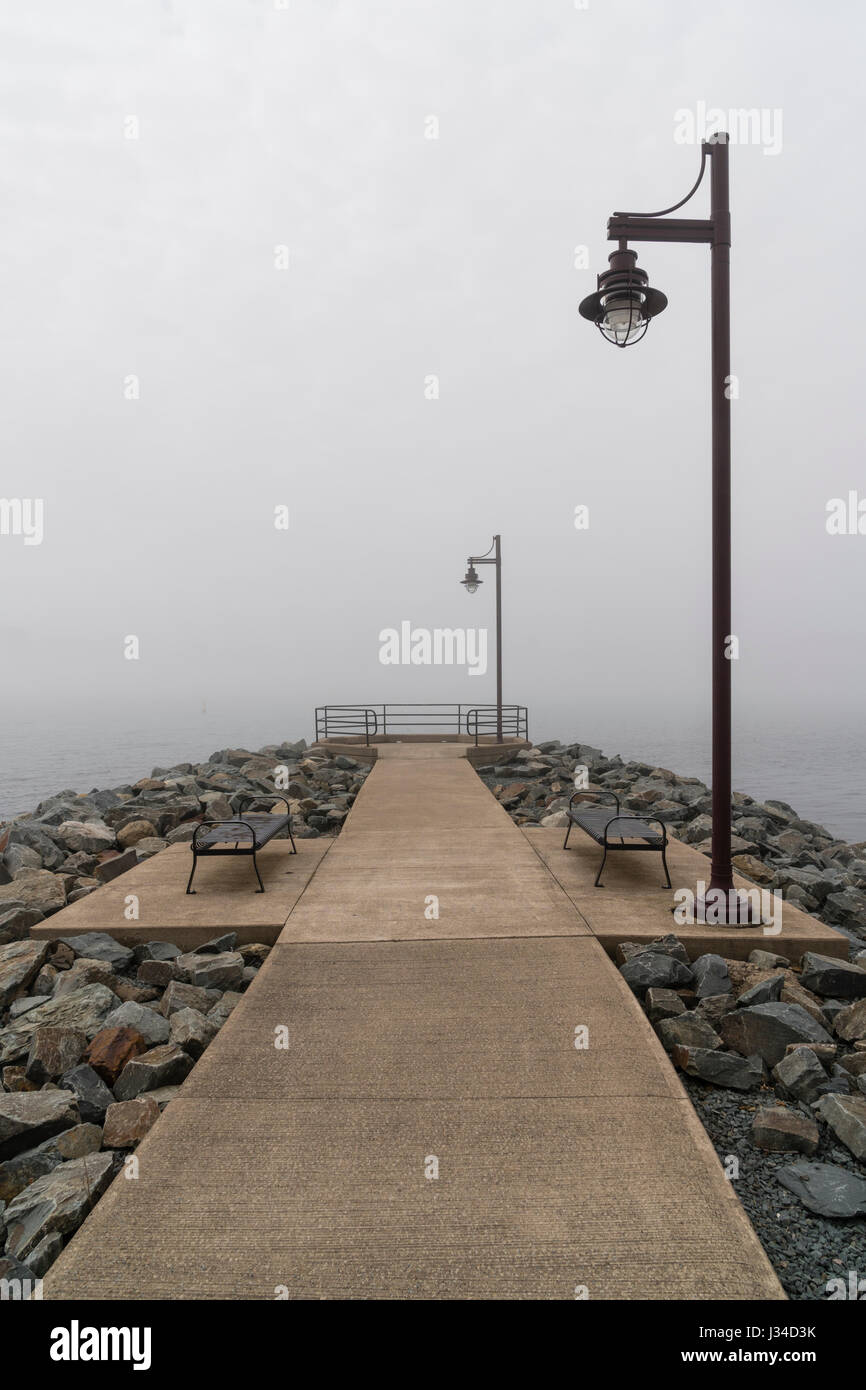 Pathway And Park Benches Set Against A Foggy Background Stock Image