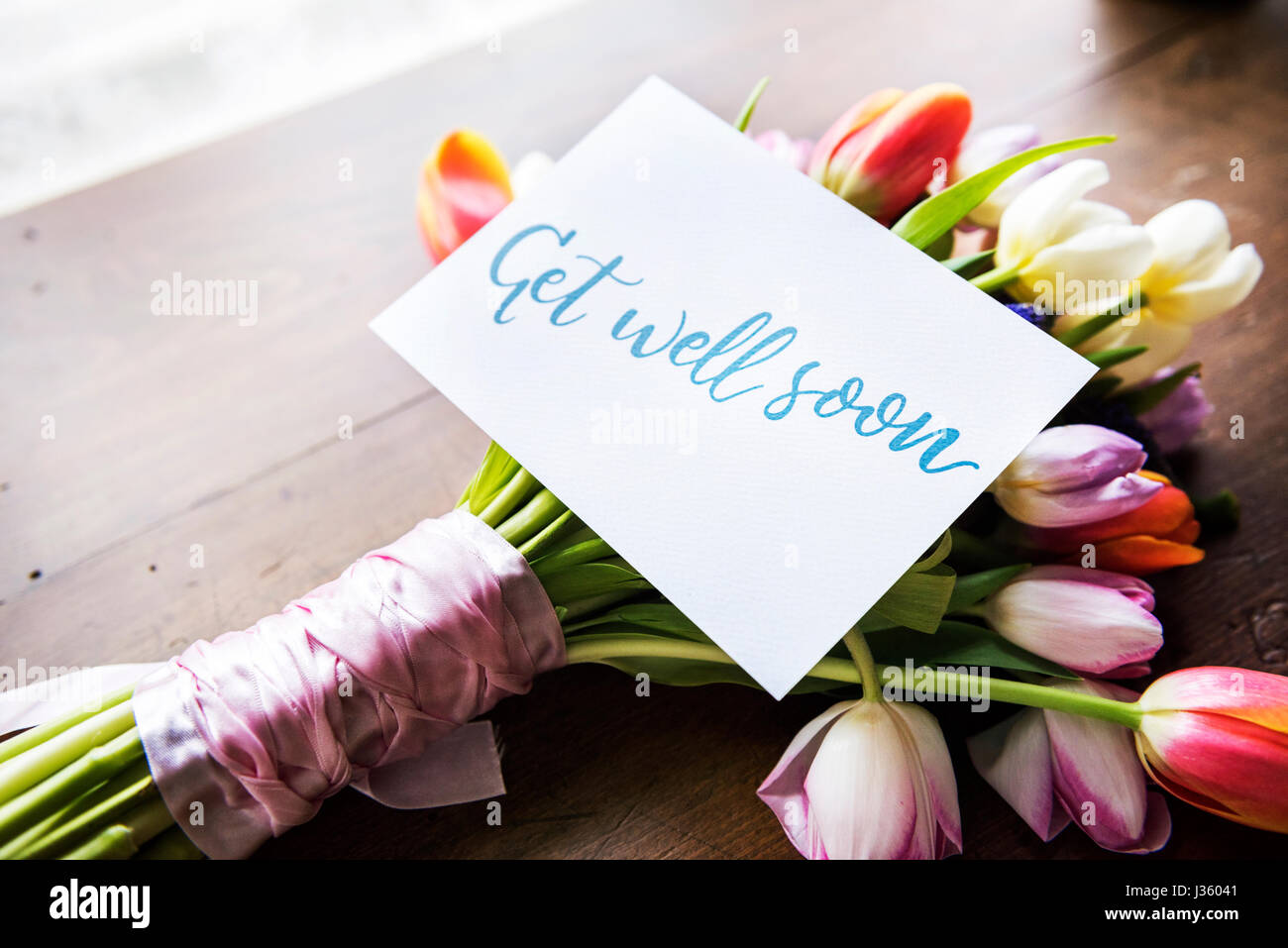 Get well soon card flowers stock photos get well soon card tulips flowers bouquet with get well soon wishing card stock image dhlflorist Images
