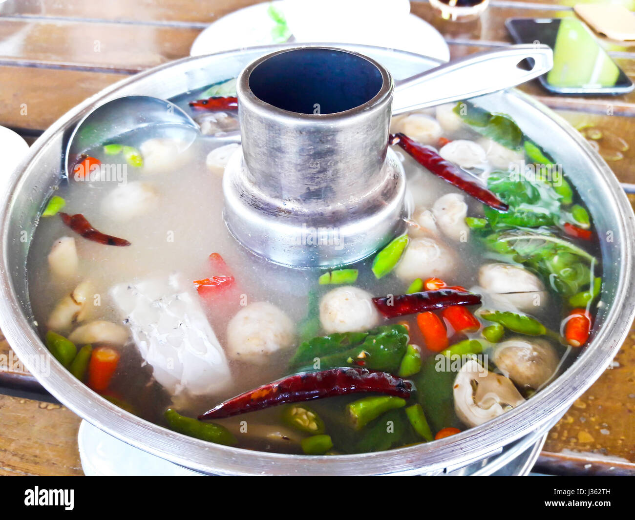 Serving Of Spicy Fish Soup Thai Style In A Hot Pot Stock Image