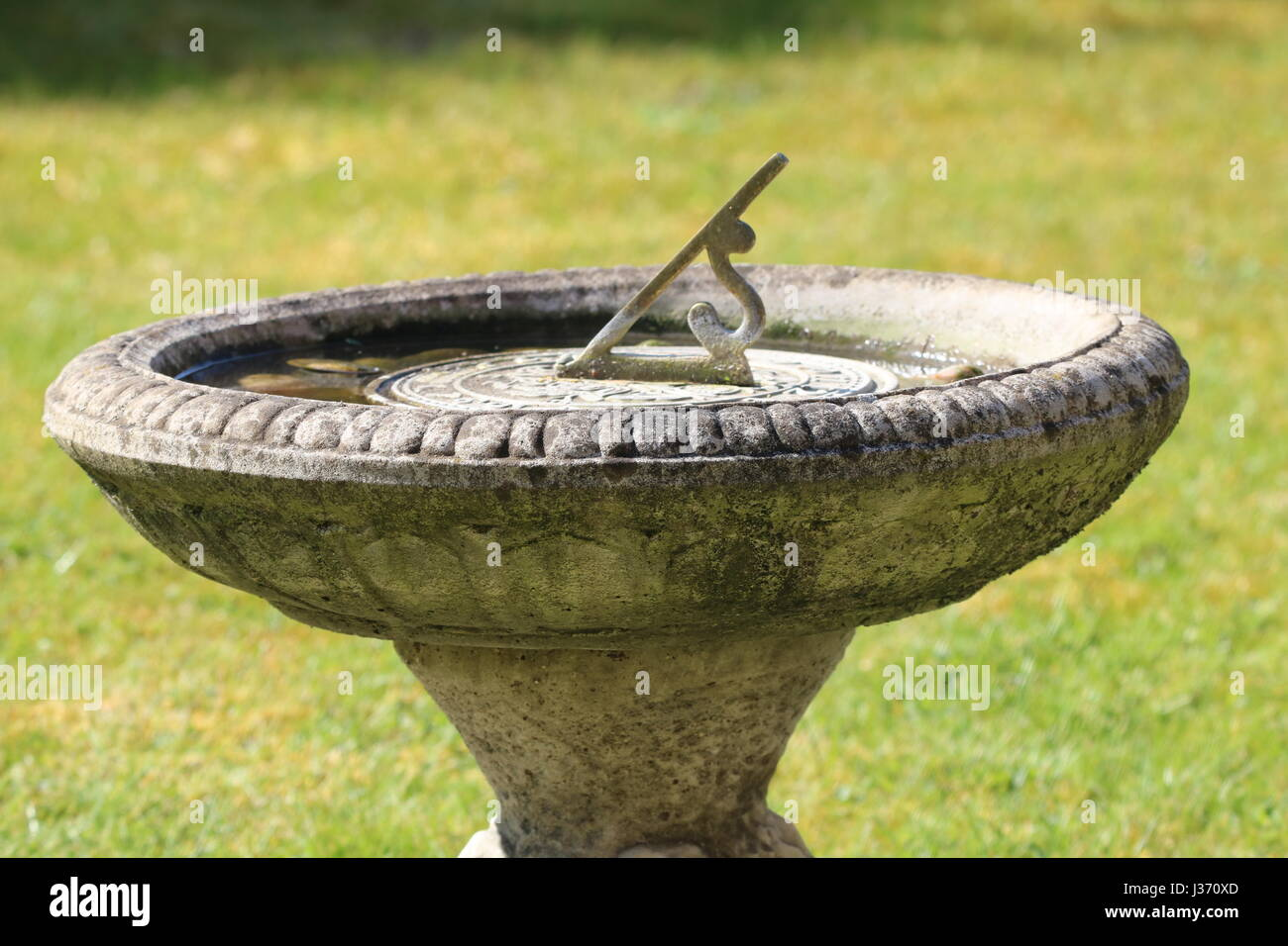 Sundial garden ornament - Stone Feature Garden Sundial Stock Image