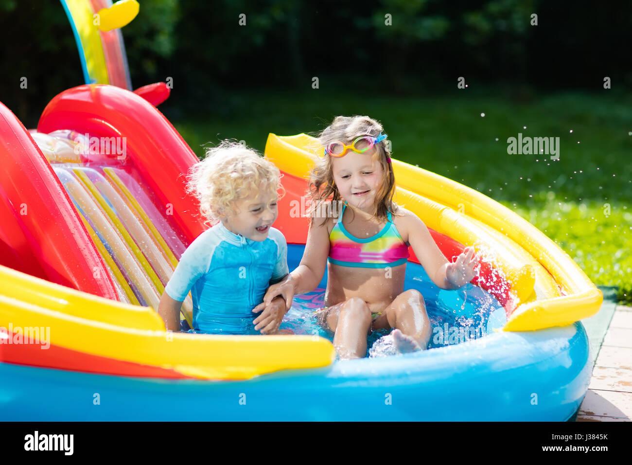 Water play garden children stock photos water play for Baby garden pool