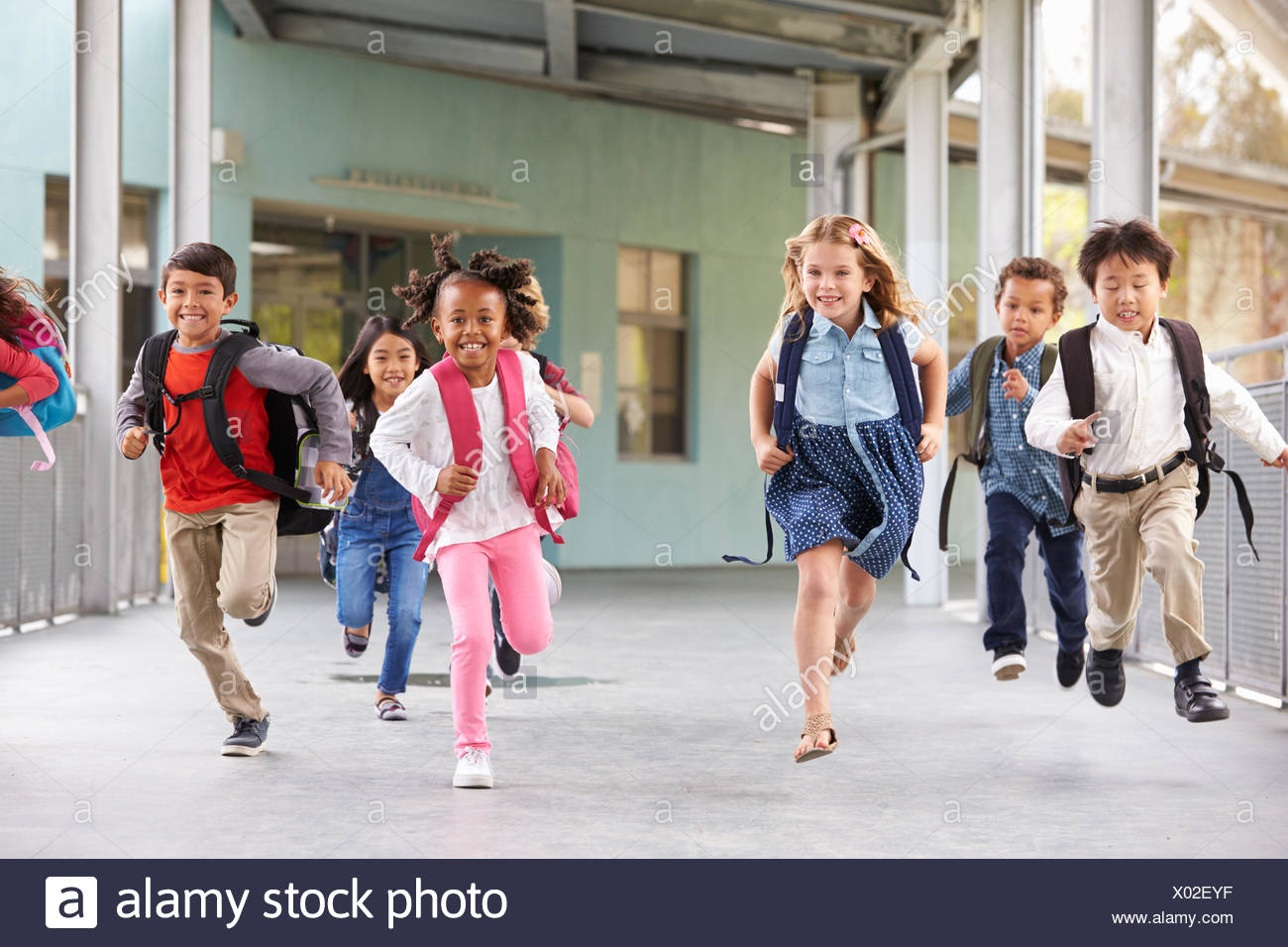 cb7cbd6e341 Group of elementary school kids running in a school corridor Stock ...