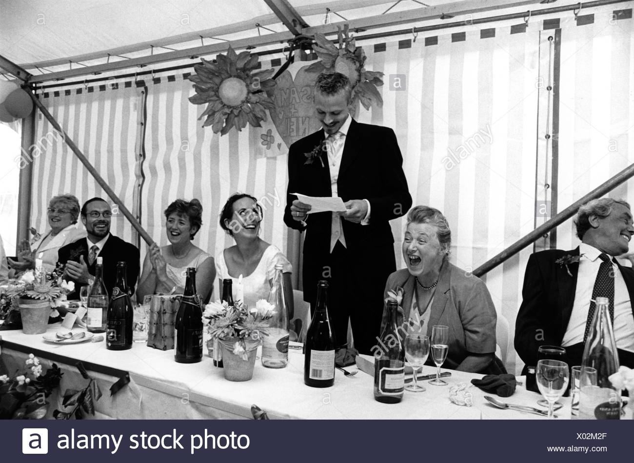 Groom Making Speech At Wedding Reception Uk Positive Use Only Stock