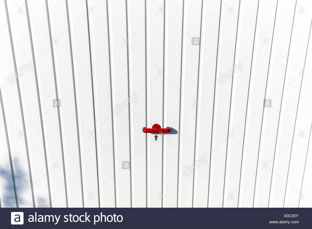 Locked Door At A Parking Garage With Red Handle Stock Photo