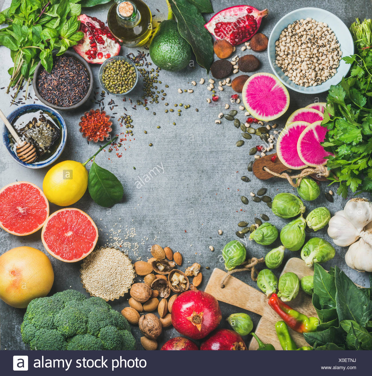 Clean eating concept. Variety of vegetables, fruit, seeds, cereals ...