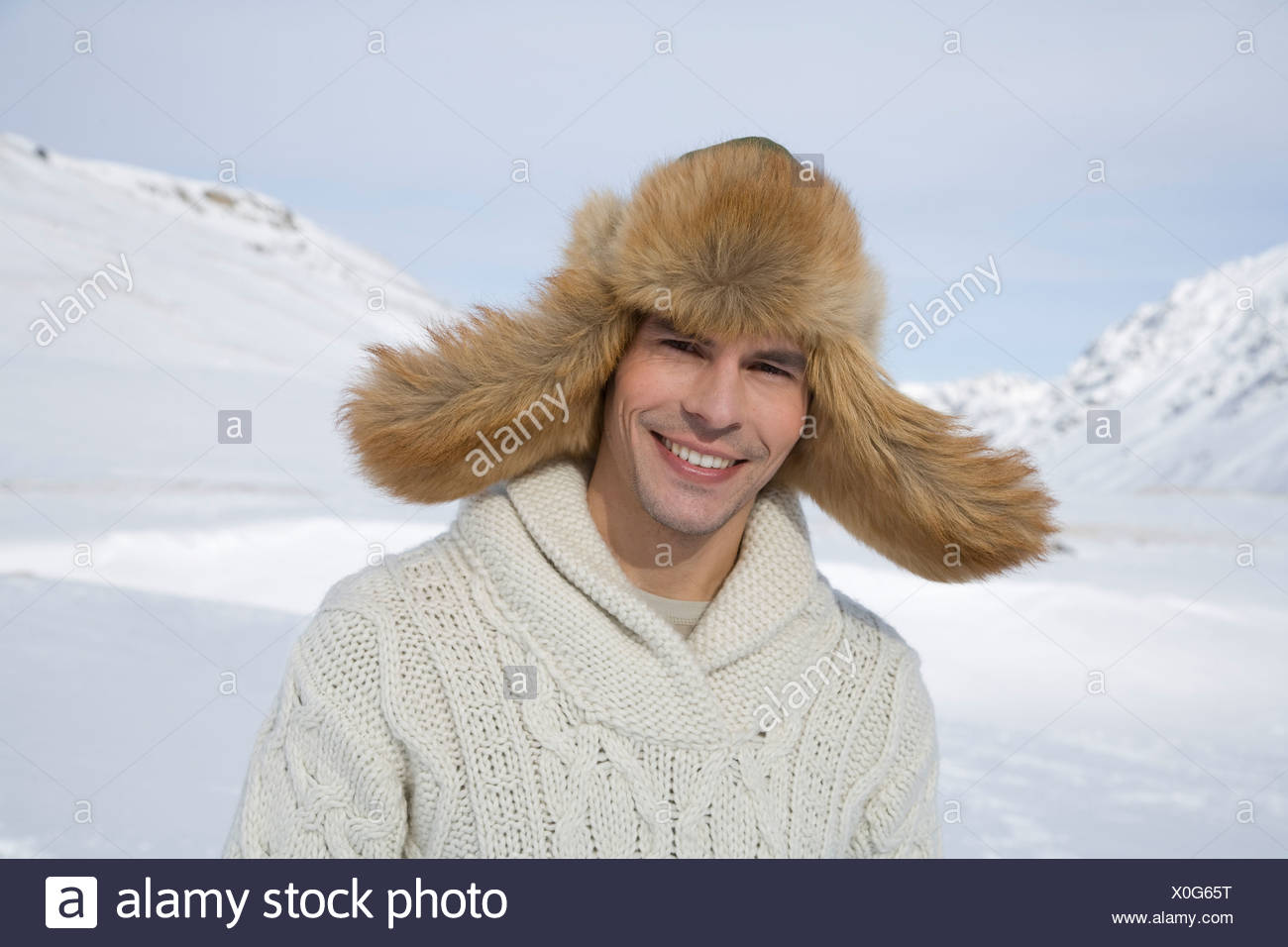 Portrait of mid adult man in fur hat on winter day Stock Photo ... d2e9dcdd8e8d
