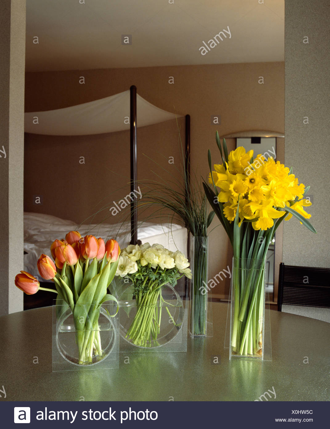 Bon Yellow Daffodils And Red Tulips In Vases On Table In Modern Bedroom