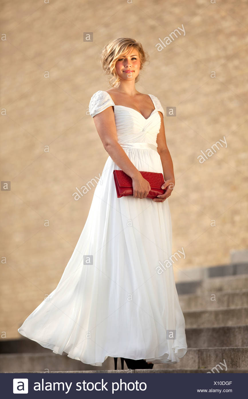 Full length portrait of a beautiful teenage girl in white ball gown ...