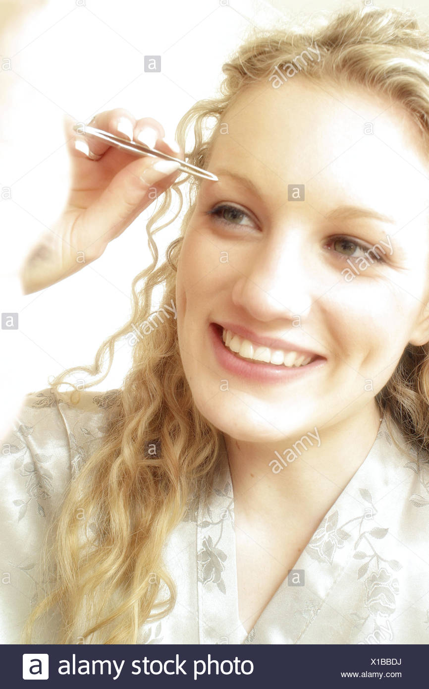 Woman Is Picking Her Eyebrows Stock Photo 276231022 Alamy