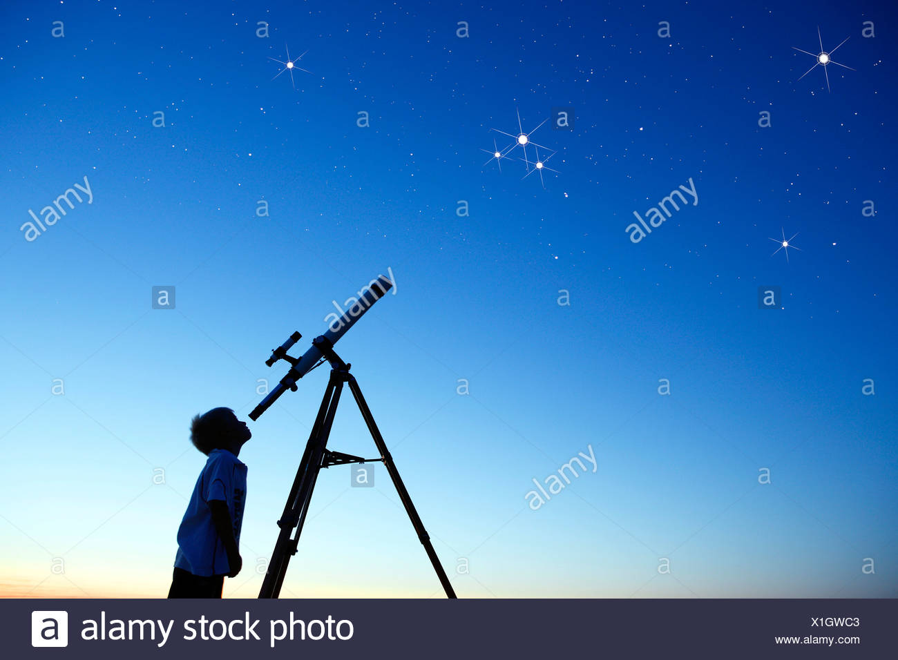 little boy looking at sky with telescope stock photo 276351715 alamy