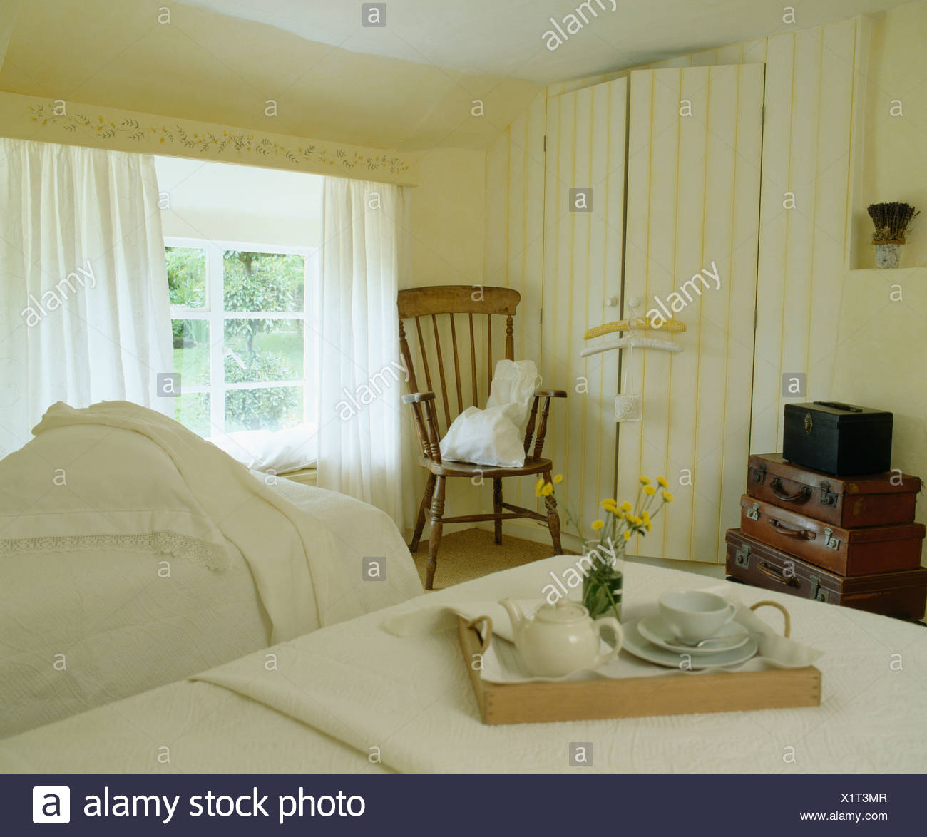Twin Beds In Bedroom With Breakfast Tray In Cream Country Bedroom With  White Curtains On Window And Yellow Striped Wall Paper