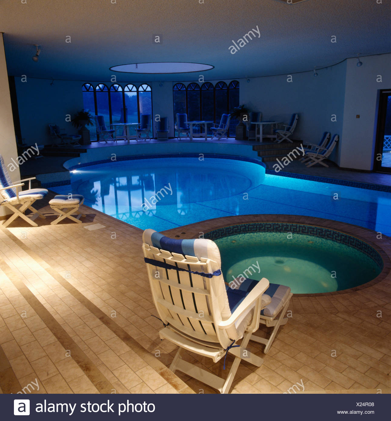 White loungers beside spa tub and eighties private indoor swimming ...