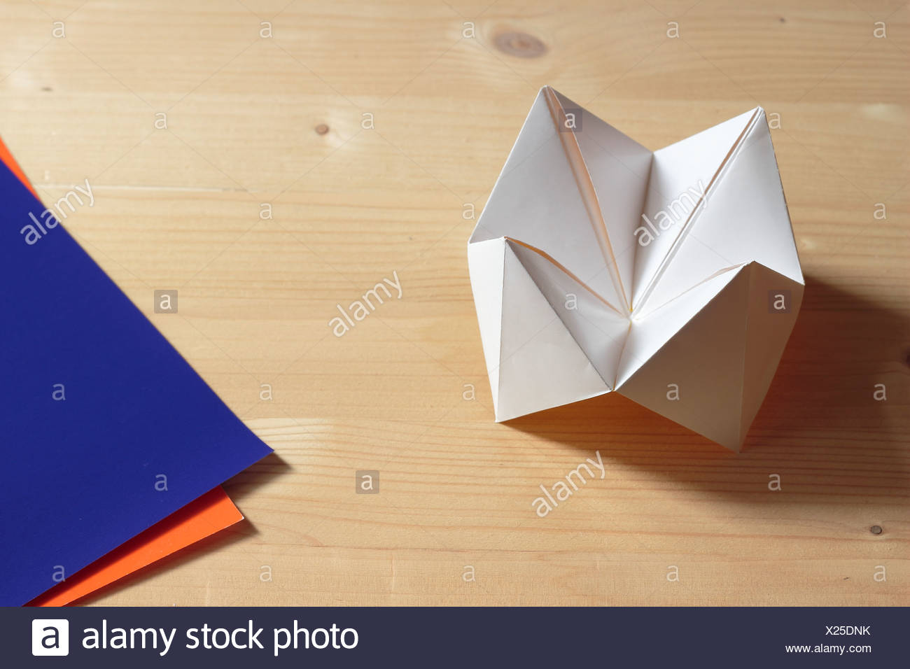 Paper fortune teller game stock photos paper fortune teller game origami fortune teller on wooden table stock image jeuxipadfo Images
