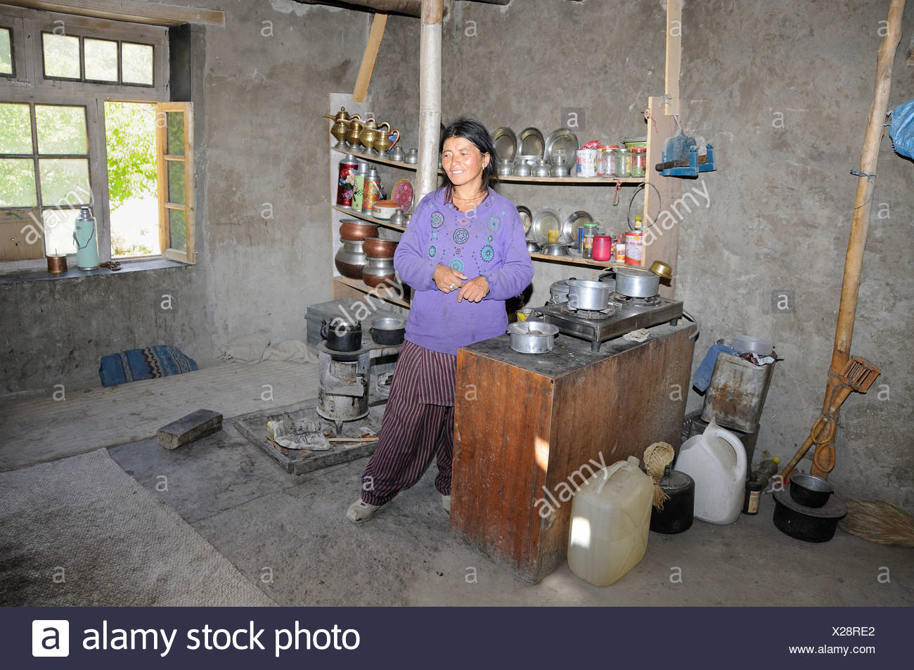 Incroyable Peasant Woman In Her Kitchen, With Metal Work, Copper And Brass Plates On  The Shelves Of The Former Coppersmith, Chiling, Zansk