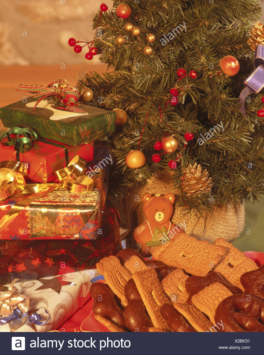 Christmas tree, Christmas presents, plates, biscuits, curled ...