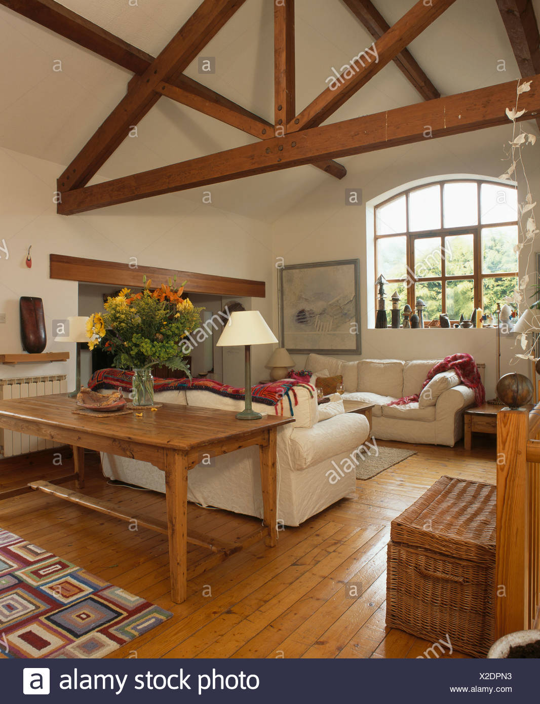 Reclaimed Wood Table And Pine Flooring With White Sofas In Living Room With  Wooden Beams On Apex Ceiling