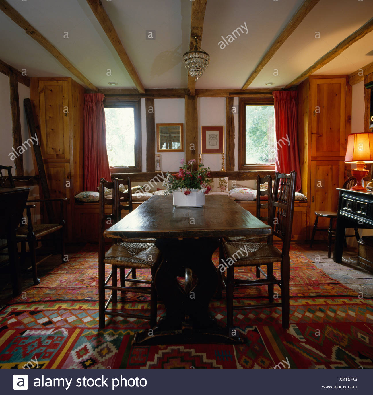 Antique oak table and chairs in country dining room with kelim rugs on the  floor - Antique Oak Table And Chairs In Country Dining Room With Kelim Rugs