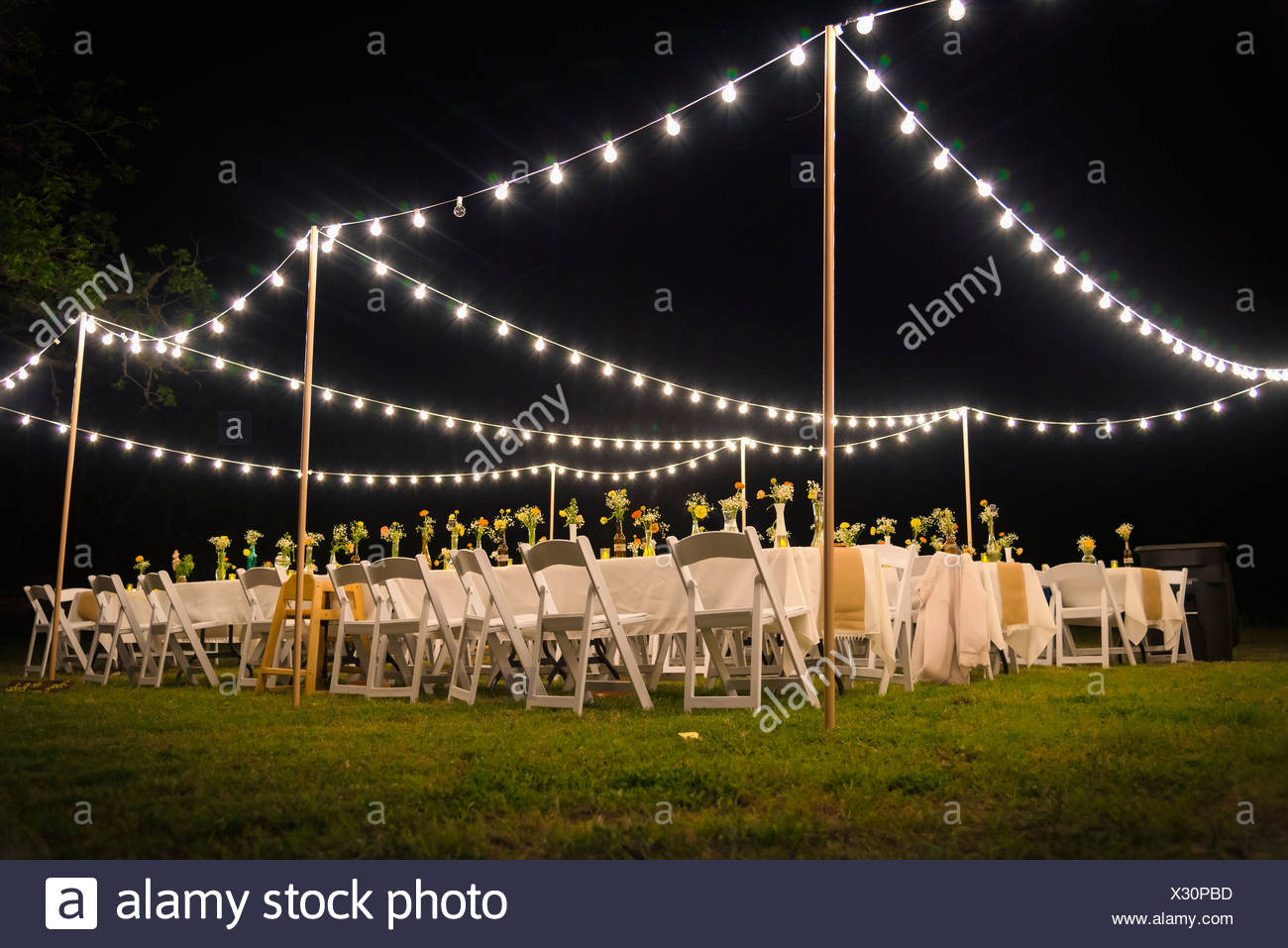 USA, Texas, Outdoor wedding reception with party lights at night ...