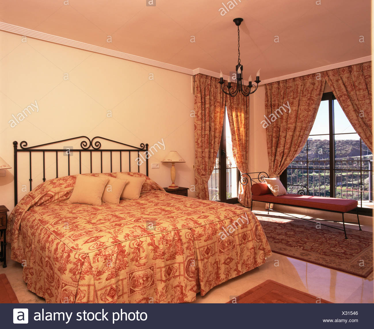 Toile De Jouy Quilt On Wrought Iron Bed In Spanish Bedroom With