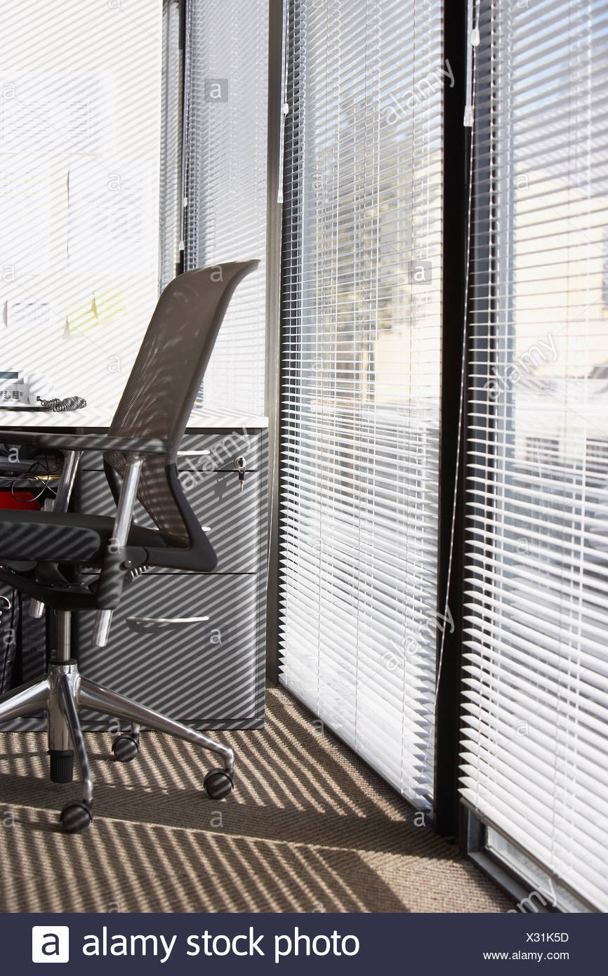 blinds for large windows roman office chair with horizontal blinds on large windows stock photo
