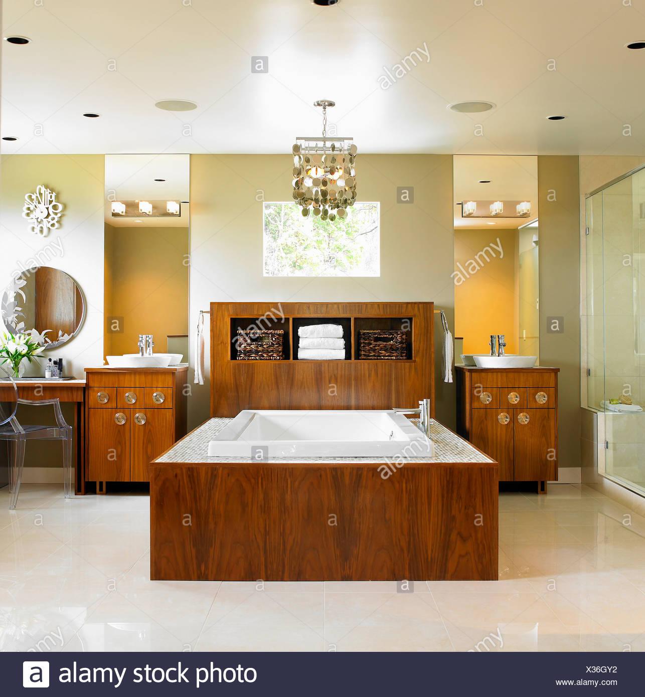 Neutral modern bathroom featuring bathtub with wood surround victoria vancouver island british columbia canada