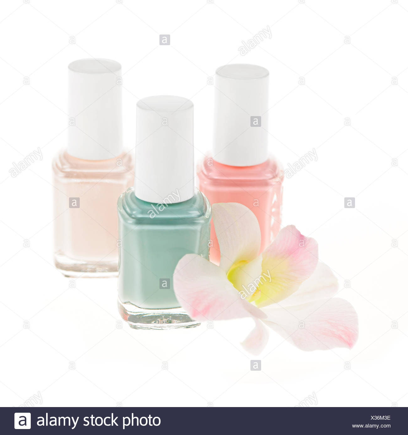 Three nail polish bottles with orchid flower on white background three nail polish bottles with orchid flower on white background izmirmasajfo