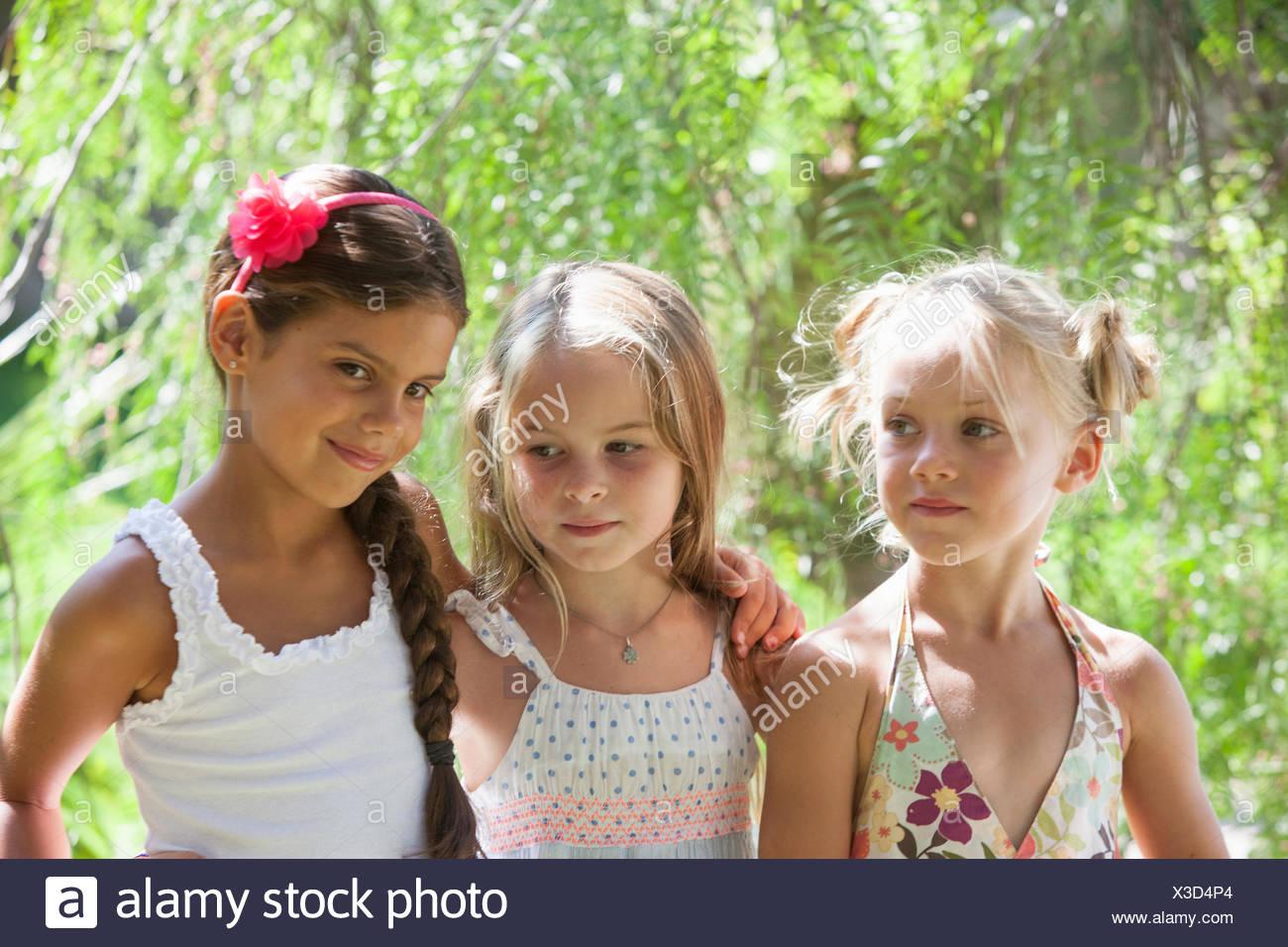 candid portrait of three girls in garden stock photo: 277498988 - alamy