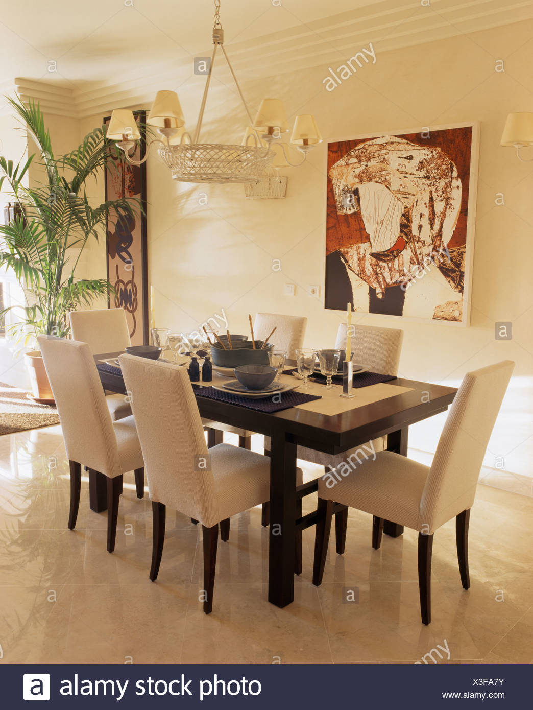 Tall Back Cream Upholstered Chairs And Black Table In Modern White Dining  Room With Abstract Picture On The Wall