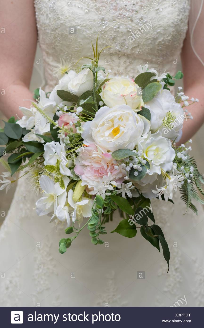 Wedding bouquet held by the bride made up of fake flowers but looks wedding bouquet held by the bride made up of fake flowers but looks like real florals izmirmasajfo