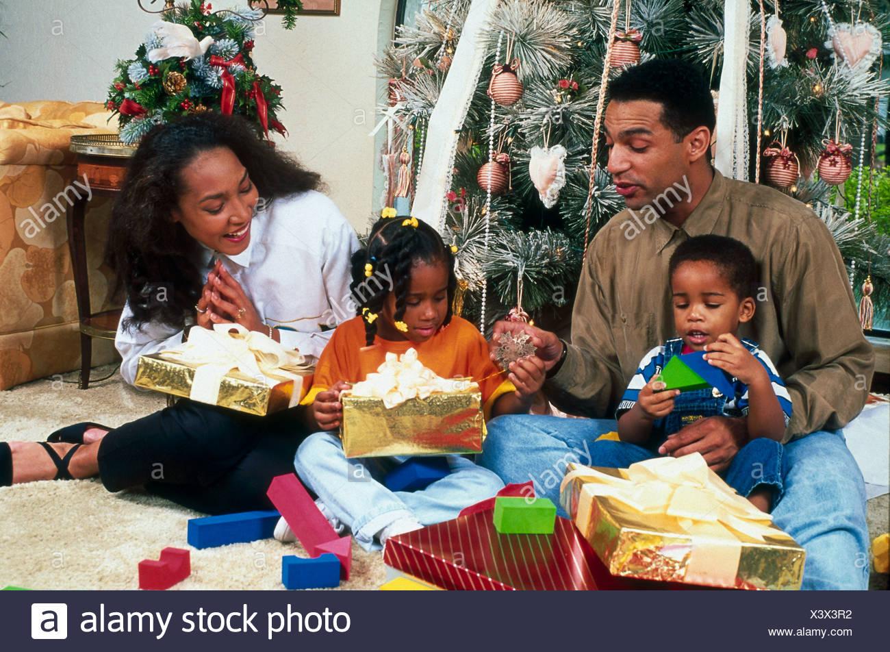 Family unwrapping christmas gifts USA Stock Photo: 277783606 - Alamy