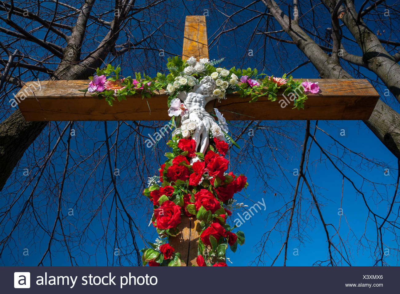 Crucifix Decorated With Flowers In Tarnow Lesser Poland Europe