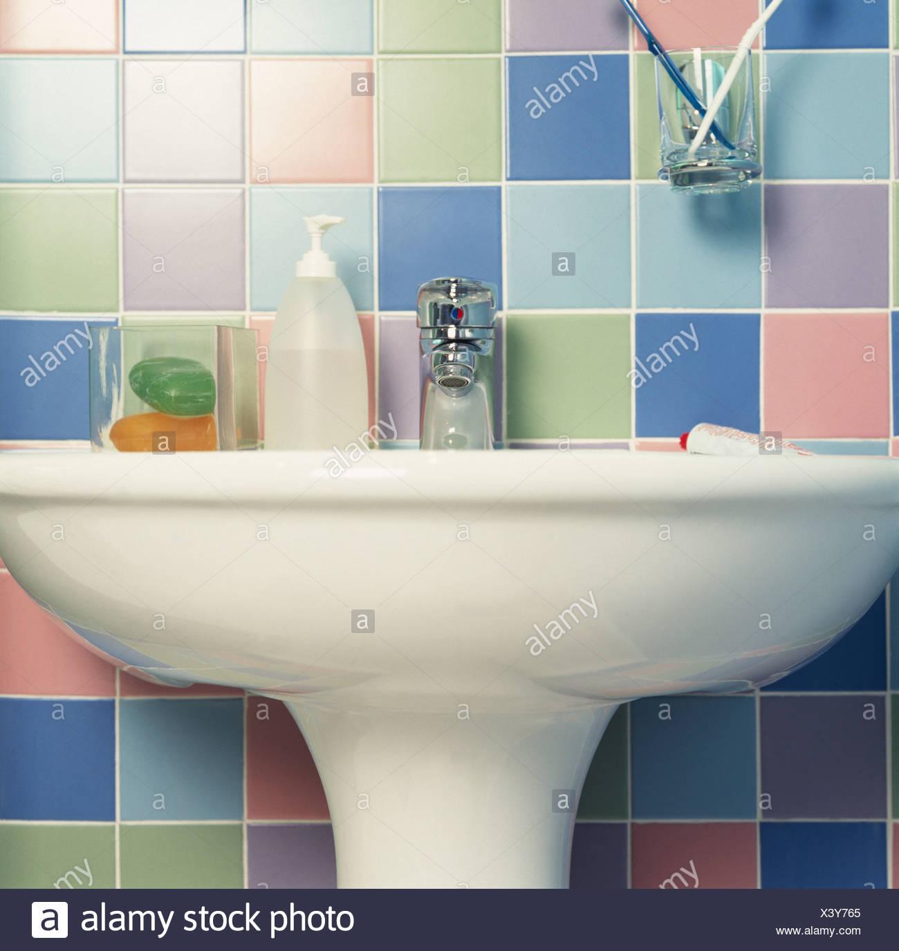 Coloured tiles behind bathroom basin Stock Photo: 277808221 - Alamy