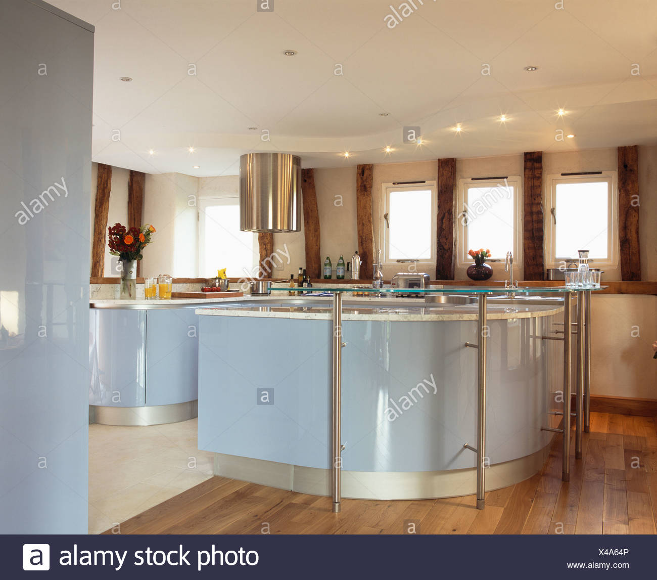 Pale Blue Lacquered Fitted Units In Modern Country Kitchen With Recessed  Lighting On False Ceiling