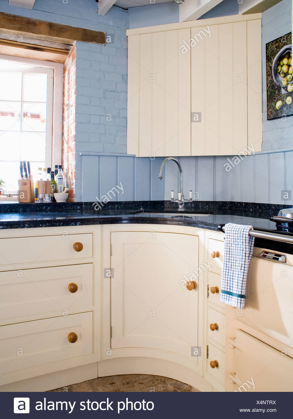Cream corner cupboard above sink in pale blue country kitchen with cream fitted cupboards and units & Cream corner cupboard above sink in pale blue country kitchen with ...
